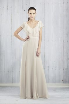 The Cecelia features a front and back v-neck with a soft drape ruffle for a flattering feminine look.  Natural waist, fitting through the high hip and gently shaping into an