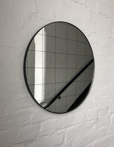 Delightful crafted silver round mirror with an elegant black frame and black grid.  Ideal above a console table in the hallway, above a beautiful fireplace, in the bedroom or in the bathroom.  Design tip: looks stunning used as a cluster in different sizes and/or colours.  Framed mirror available in 50cm, 60cm, 80cm & 100cm  (depth 18mm).