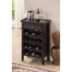 This elegant dark brown wood wine cabinet fits many wine bottles in a small space. Constructed of eco-friendly rubber wood and engineered wood, this functional wine storage cabinet has a convenient drawer and removable tray for your wine accessories.