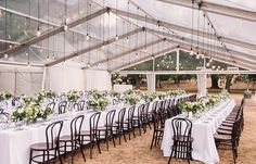 White wedding reception with hanging lights