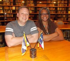 UNCC staffers Joshua Burford and Meredith Evans, pictured here in the reading room of the UNC-Charlotte Archives, want to collect and preserve local LGBT history. File Photo.