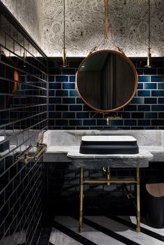 Two Tom Dixon COG pendants light this Hong Kong bathroom. Aged Italian brick…