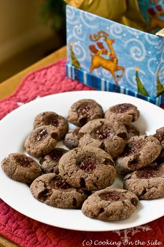 Chocolate-Raspberry Thumbprint Cookies…get the recipe at www.cookingontheside.com #holiday #cookies #chocolate