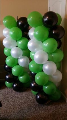 Balloon columns for Monster Jam birthday party..just need to add the foil balloons to the tops of them! (Grave Digger inspired)