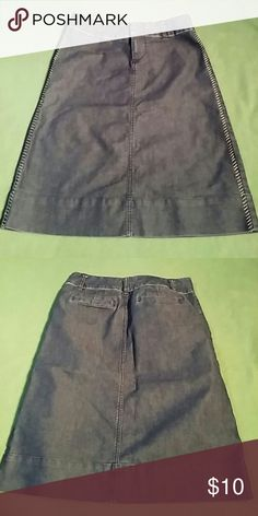 Appstrophe dark denim skirt Skirt has no splits. Sewn detail on both sides. Light weight denim. Length is 22 1/2 inches. Apostrophe Skirts A-Line or Full
