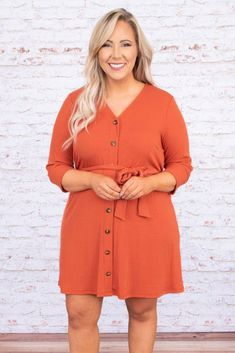 This dress is as beautiful as the Midwest sky! It has a bold orange color with a solid fabric you can style for every occasion! It's comfortable for all day wear, has a figure-flattering tied waistline, and features the cutest buttons! Simply, style this dress with booties or sandals for your next event! Material has Fall Family Picture Outfits, Fall Outfits, Plus Size Fall Outfit, Orange Fashion, Walk This Way, Bold Stripes, Orange Dress, Cozy Sweaters, Distressed Denim