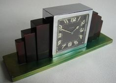SWISS ART DECO CHROME AND BRONZED METAL EIGHT DAY MECHANICAL DESK CLOCK ON GREEN ANNODIZED BASE.