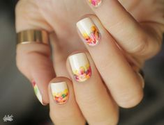 Would you like to know how it feels to have flower grow right out of your nails? This amazing flower inspired summer nail art that will surely blow your mind. The nails are coated in white polish and accents of flowers with colorful hues are added on top. Very pretty and simple, something that you can wear everyday on your nails.