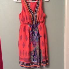 Gorgeous Orange Dress I'm gonna miss this one but I've only worn it once. Orange with all color print. Vneck. Fits true to size. Comes to mid thigh. Amazing condition. Bought from Belk. Dresses Midi