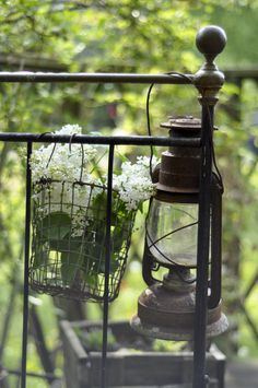 Lantern on a metal bed frame