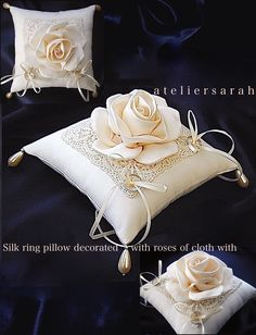 Silk ring pillow decorated with roses and lace made from cloth with