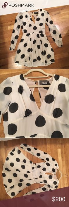 Reformation white/black silk polka dot mini dress Reformation, white silk long sleeve dress skin black polka dots; cut out circle in back, deep plunging V neck; hangs just above the knees Reformation Dresses