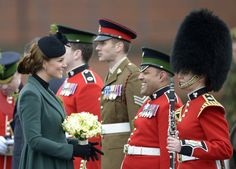 Kate Middleton Goes Green For St. Patrick's Day: Kate Middleton wore a green coat.  : Kate Middleton leaned on Prince William to un-wedge her heel from a grate.  : Kate Middleton met with military personnel.