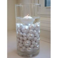 love the huge pearls. A couple of these would look great in the bathroom