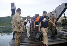 POHNPEI, Federated States of Micronesia- Members of the Pacific Partnership 2011 team exit Landing Craft Utility (LCU) 1665 in Pohnpei.