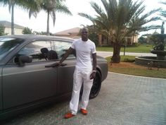 former OSU reciever, Chad Ochocinco (Johnson), wearing orange slippers