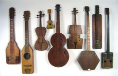 9 antique folk art early American home made musical instruments. Dating from the 1870's to the 1940's. Includes guitars, banjos and violins