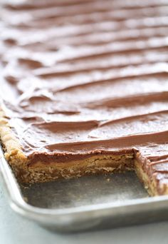 These Homemade Lunch Lady Peanut Butter Bars are the BEST DESSERT EVER. These Lunch Lady Peanut Butter Bars have a peanut butter cookie base, creamy peanut butter center and chocolate buttercream frosting. Peanut Butter Cookie Bars, Peanut Butter Chocolate Bars, Best Peanut Butter, Peanut Butter Desserts, Cookie Desserts, Fun Desserts, Delicious Desserts, Dessert Recipes, Bar Recipes