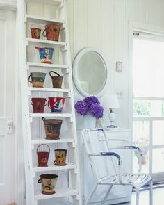 Here is a fun collection of vintage sand pails.  The ladder is a clever display idea.