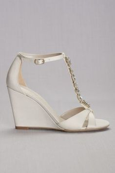 8e5e84d91da9 A crystal strand embellishes the vamp of towering satin T-straps wedges. By  David