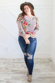 3aa61a4485145 Lena is wearing our wine stripe and floral top paired with dark denim