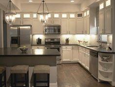 Kitchen makeover: added lit cabinets above painted originals