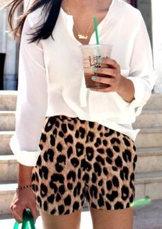 cheetah shorts and a loose white tee.