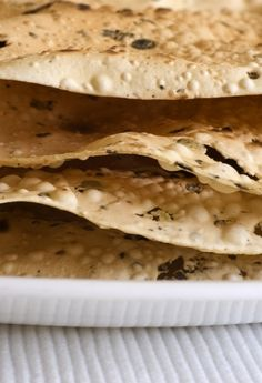 Pane Carasau | Flat Bread, Sardegna  Pane carasau is a traditional flatbread from Sardinia. It is thin and crisp, usually in the form of a dish half a meter wide. It is made by taking baked flat bread, then separating it into two sheets which are baked again.
