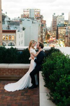 Adorable rooftop NYC wedding: http://www.stylemepretty.com/new-york-weddings/new-york-city/2016/05/23/designer-dress-a-list-florist-celebrity-photographer-this-manhattan-wedding-is-a-must-see/   Photography: Trent Bailey Studios - http://www.trentbailey.com/