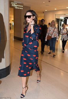 Paying lip service: She wore a printed co-ord from her eponymous collection with strappy s...