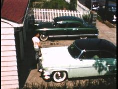 Our 55 Lincoln Capri and my brother's Packard...year???
