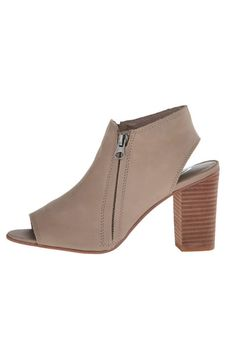 These leather peep toe booties are a staple for your shoe collection. They work perfectly with anything from denim to a sundress. They only come in half sizes so if you're in between we recommend going up to the next size.  Peep-Toe Heeled Bootie by Sbicca. Shoes - Booties Wallingford Connecticut