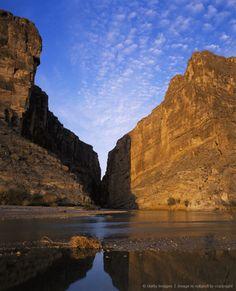 Mouth of Santa Elena Canyon and its reflection in Rio Grande River. Rio Grande River, Santa Elena Canyon, Big Bend National Park, Texas.
