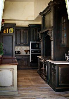 reminded me of your island and floors. a distressed black/brown for the outter cabinets might be good