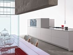 Fitted kitchen with integrated handles TRIM by DADA   design Dante Bonuccelli