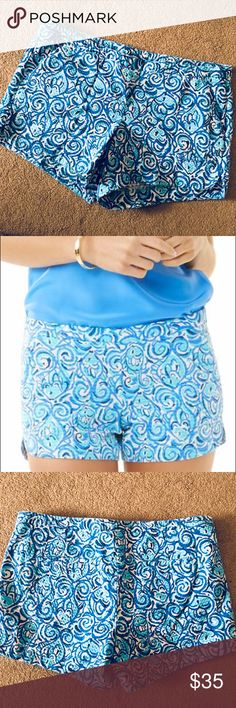 "Lilly Pulitzer Adie Shorts Lilly Pulitzer ""Adie"" style shorts featured in Chasing Tail blue fish print. These shorts are super soft textured cotton with a hidden hip zipper and front hip pockets along with 2 back pockets. Inseam measures 4"" and waist measures 17"" laying flat. Offers accepted. Lilly Pulitzer Shorts"