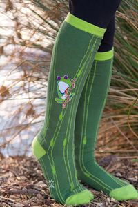 "Sweet little green tree frogs peer bashfully from their reedy abode. Don't let their expressions fool you: these knee highs are bound to give you ""hoppy"" feet!"