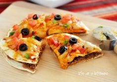 Mexican Pizza  Made this for dinner. Quick, easy and delicious. Also its easy to adapt it for vegetarian eating. (I used black refried beans, red onions and added pickled jalepenos)