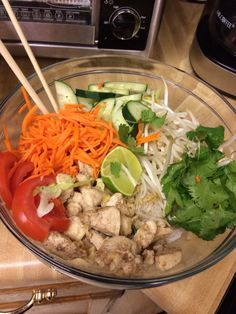 Vietnamese chicken and vermicelli. The chicken is cooked with homegrown lemongrass, garlic, olive oil, and star aniseed powder. The carrots are pickled with rice vinegar, sugar and salt. Add fish sauce and Sriracha to taste :) So good.