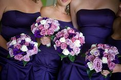 Bridesmaid bouquets in varying shades of purple; I think I see my bouquet being more white with touches of purple, and the bridesmaids' being more purple and (?touches of white).