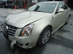 Salvage 2013 CADILLAC CTS LUXURY   THIS IS A SALVAGE REPAIRABLE VEHICLE WITH RIGHT FRONT AND SIDE DAMAGE. THE VEHICLE RUNS , DRIVES AND IS AWD. For more information and immediate assistance, please call +1-718-991-8888