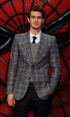 Andrew Garfield, while his sweater seems odd for July, is nonetheless knocking it out of the park.