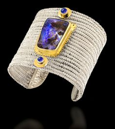 Australian boulder opal, tanzanites, 22k gold, fine and sterling silver. by Cynthia Downs