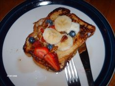 Tonga Toast (Rainforest Cafe) from Food.com:   We had this when we visited Disneyland...so yummy!  Mine came w/o pecans but the last time my friend had this it came with them so it's in the recipe as an option.