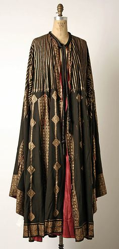 Evening coat Design House: Fortuny  (Italian, founded 1906) Designer: Mariano Fortuny (Spanish, Granada 1871–1949 Venice) Date: 1900–1933 Culture: Italian Medium: silk, glass Dimensions: Length at CB: 51 1/4 in. (130.2 cm) Credit Line: Gift of Miriam Whitney Coletti, 1985