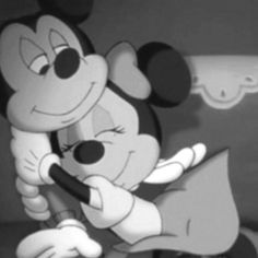 Mickey & Minnie Mouse :) The look of adoration on his face is perfect.