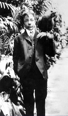Theodore Roosevelt, Jr. and his macaw, named Eli Yale.