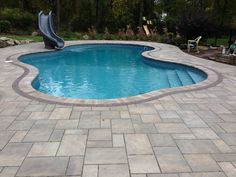 Pool Patio. Unilock Beacon Hill Seirra. Copthorn border. Landscape design by Total Package Landscaping. Outdoor living ideas
