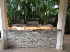 Outdoor Kitchen with lights and Delta Heat appliances completed by U.S. Brick and Block
