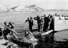 Troops of the 1st U.S. Cavalry Division land ashore at Pohang on the east coast of Korea July 19, 1950.